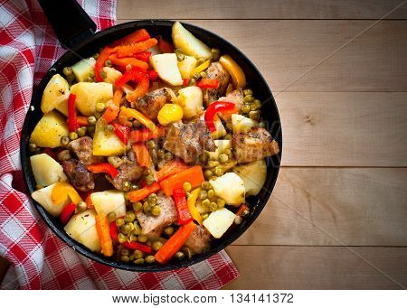 Meat with vegetables. Food in the frying pan. Main dish.