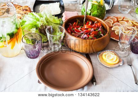 Empty Plate And Appetizers On Served Table