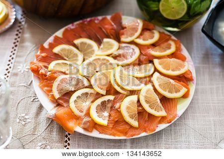 Plate With Sliced Smoked Salmon Fish With Lemon