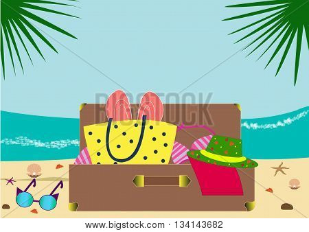 Coast and sea waves. Suitcase with summer things lie on the beach. Collect the suitcase.