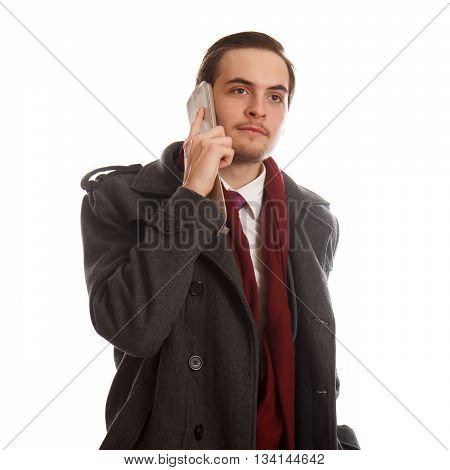 A classy businessman listening on his phone