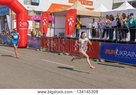 DNEPR UKRAINE - MAY 22 2016:Woman hurry to finish line during