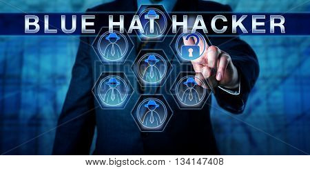 Male software developer in business suit touching BLUE HAT HACKER on a virtual control screen interface. Cybersecurity concept for a computer security consultant called in to bug test an IT system.