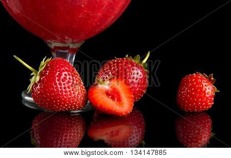 Cropped View Of Strawberries With Goblet On Black