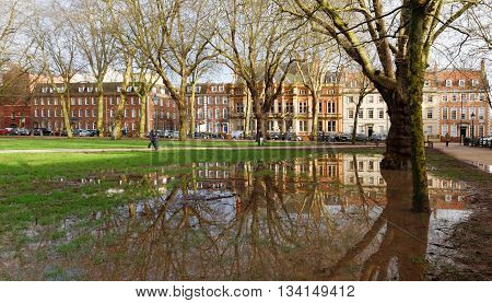 BRISTOL, ENGLAND, 22 JAN 2016. Editorial photograph of Houses of Queen Square, Bristol, England, Reflected in Flood Water After Heavy Rain