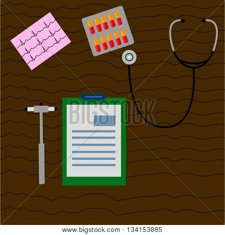 work desk doctor, physician, which are neurological hammer, stethoscope, ECG, working notes, notepad, blister with capsules