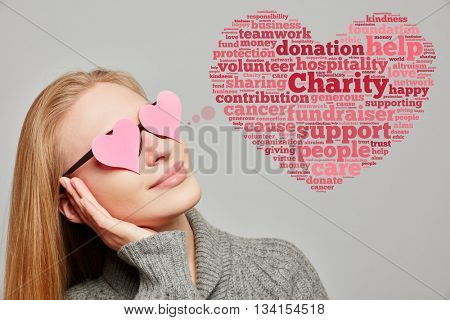 Young woman with a charity heart cloud next to her
