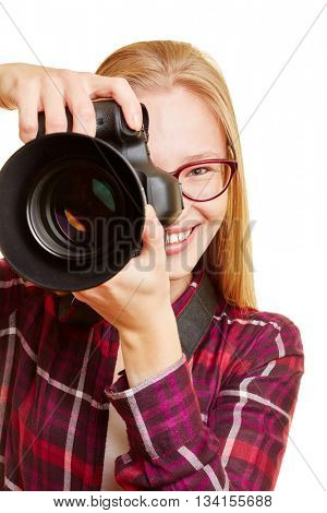 Smiling young woman with digital camera as photographer