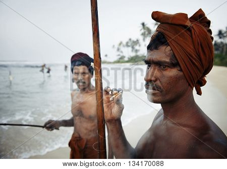 Fisherman Smoking By The Shore Concept