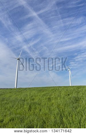 A pair of wind generators in a field.