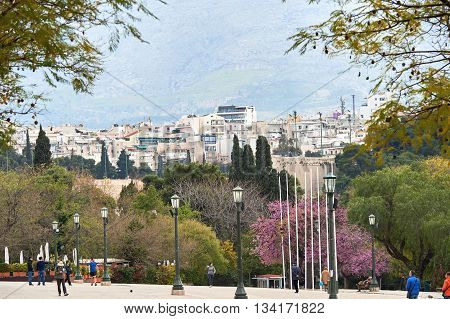 Athens Greece - March 27 2016: The National Garden or the Royal Garden the majestic public park of 15.5 hectares in the center of the Greek capital Athens behind the Greek Parliament building with touristss and locals having fun on a sunny spring day