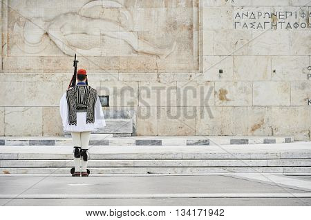 Honor Evzones guard in front of the Tomb of the Unknown Soldier at the Parliament Building in Syntagma Square Athens Greece.