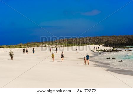 People On The Beach In Espanola Island.