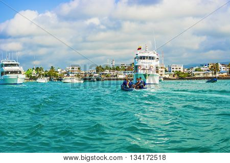 Bboats And The Buildings In The Puerto Ayora In Galapagos