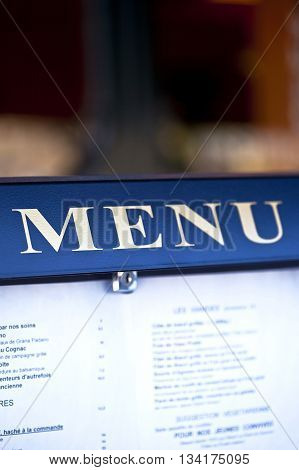 Close up of the menu in front of a French bistro