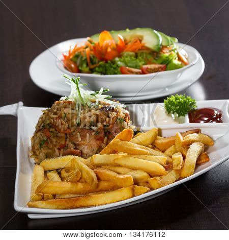 Chicken Fried Rice With Fries And A Salad