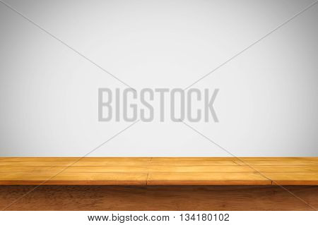 Empty wooden table with white wall background. For display or montage your products.