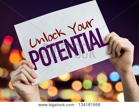 Unlock Your Potential placard with night lights on background