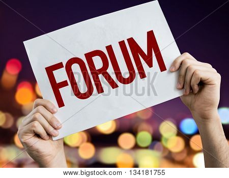 Forum placard with night lights on background