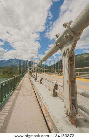Image on top of Columbia River Bridge ( Revelstoke Bridge) with no traffic on highway 1.