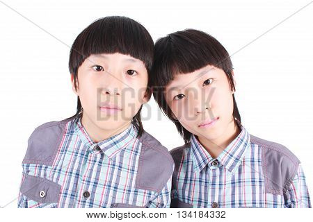 Portrait of two boys, twins on white background.