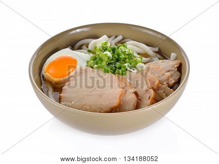 Japanese noodles Udon with chicken and boiled egg in soybean paste (Miso) soup on white background