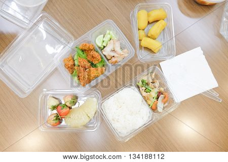 Thai lunch box set on table, top view