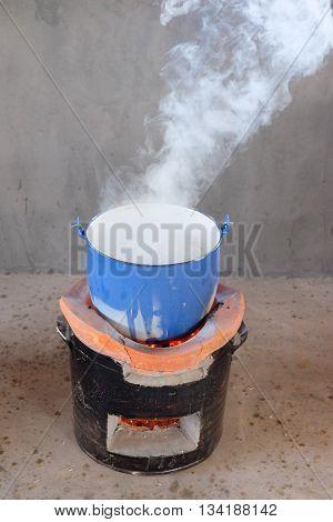 steel pot on clay stove in Thai kitchen