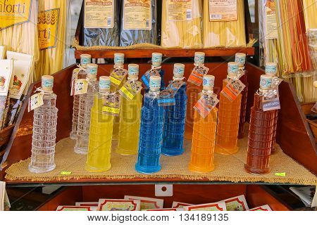 Pisa Italy - June 29 2015: Sale of national Italian alcoholic drinks at the street souvenirs shop. Province Pisa Tuscany region of Italy