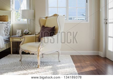 Classic Chair With Brown Pillow On Carpet In Vintage Style Bedroom Interior
