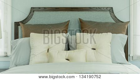 Cozy Bedroom Interior With White Pillows And Reading Lamp On Bedside Table