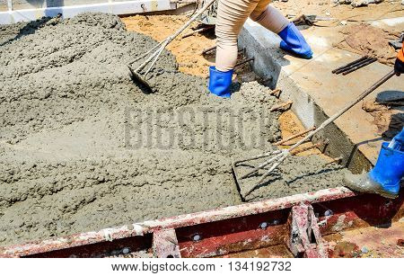 Concrete pouring work during road concreting floors in construction