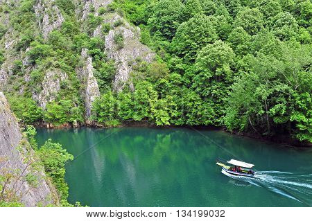 Motor boat in the river. Summer view of the Matka canyon Macedonia