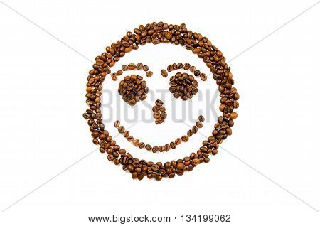 Smile, fase made of roasted coffee beans on a white background