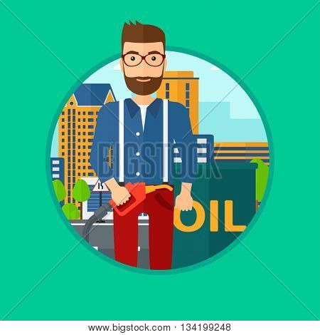 A hipster man with the beard standing near oil barrel. Man holding gas pump nozzle on a city background. Vector flat design illustration in the circle isolated on background.