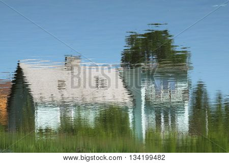 reflection of a house on the water surface