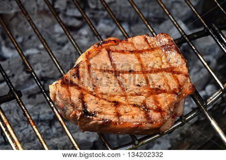 One Meat Steak Ready Cooked On Grill