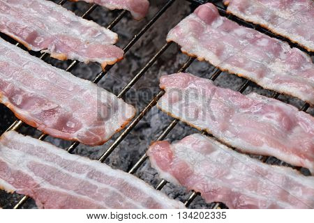 Raw Smoked Bacon Slices Cooked On Bbq Grill
