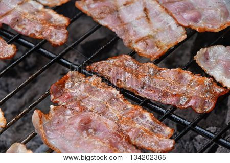 Crispy Smoked Bacon Slices Cooked On Bbq Grill