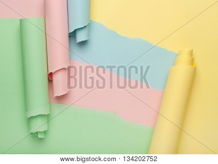 Some torn colorful paper forming abstract background