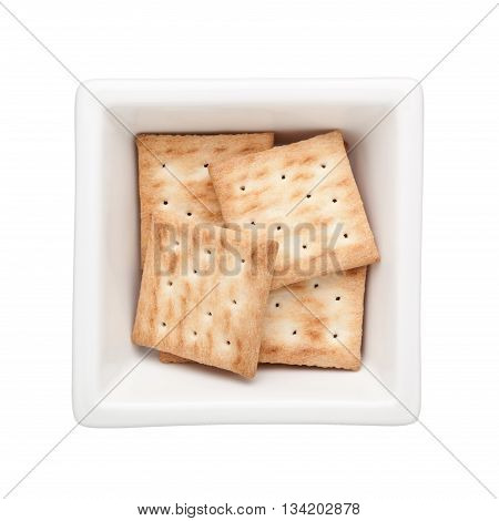 Square biscuits in a square bowl isolated on white background