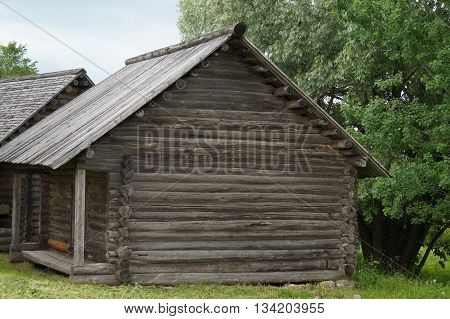 Russian village, wooden architecture, the house and the barn for storage of accessories