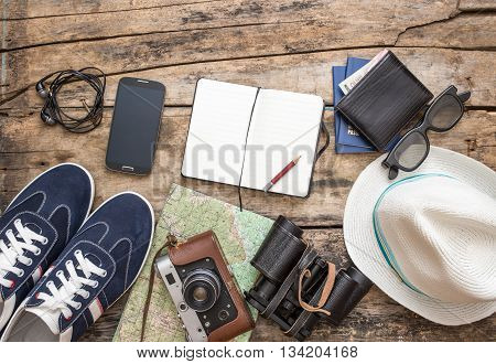 Set Of Accessories For Travel On Wooden Background