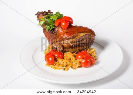 German traditional dish Knuckle on a white plate