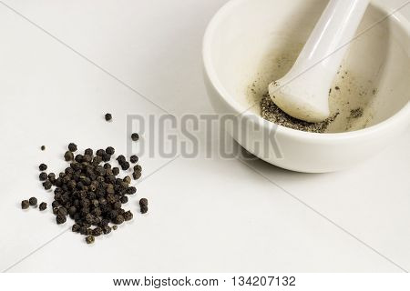 Peppercorn fragrant and ground in a mortar subject shooting