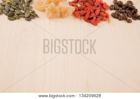 Goji Berries, Seeds, Coffee, Ginger, Wooden Table With Copy Space