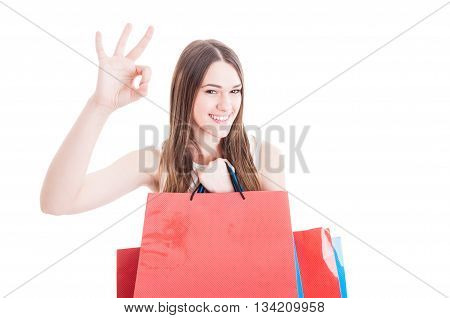 Happy Friendly Girl Doing Shopping And Showing Ok Sign
