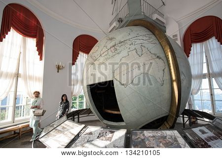Saint-Petersburg Russia - May 23 2016: Big Gotorpsky globe-planetarium in the State Museum of Anthropology and Ethnography (Kunstkamera). Made in Germany in the 17th century and given to Russia.