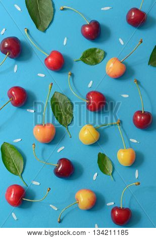Abstract cherry isolated on blue papper, close up