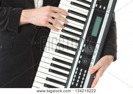 Music synthesizer in male hand. Rock Concert